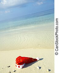 Christmas hat on a beach - Christmas hat on a white sandy...
