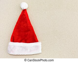 Christmas hat on a coral sandy beach