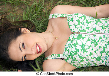 Beautiful girl laying on the grass