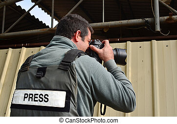 Professional Photojournalist - A press photographer takes...