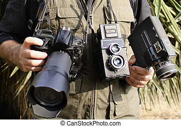 Photographer - A wildlife photographer wearing many cameras...