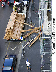 Disasterin a construction site - Disaster with wood in a...