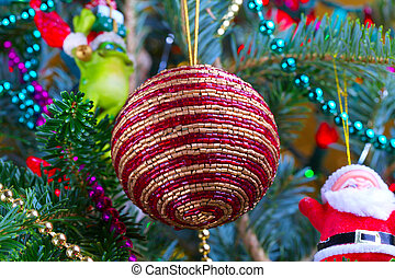 Christmass Tree - Red and gold beaded ornament on the...