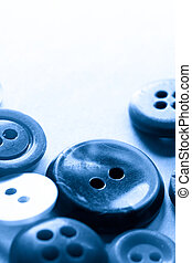 A pile of buttons in blue