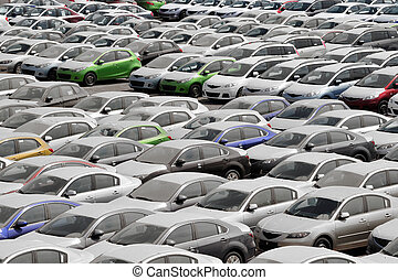 Many Cars - Many cars parked in a large car parking space...