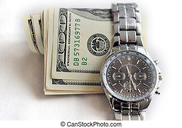 Time Is Money - A watch shows the time over American Dollars...