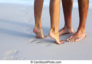 Couple is on the sandy beach