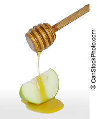 Rosh Hashanah - Honey dipper stick drips honey on a green...