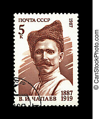 USSR - CIRCA 1987: cancelled stamp printed in the USSR, shows famous russian millitary commander Vasiliy Chapaev, circa 1987. civil war 1920s history. vintage post stamp on black background.