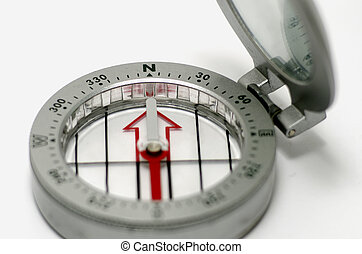 Compass - A silver and red Compass on a white background
