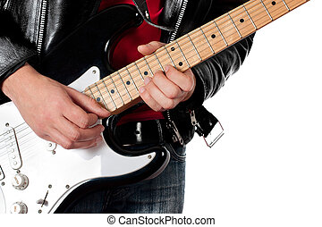 Young guy in leather jacket playing electric guitar on white