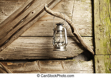 oil lamp hanging against wooden background