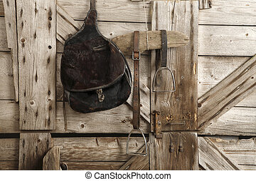 saddles - Saddles and bridles in the stable