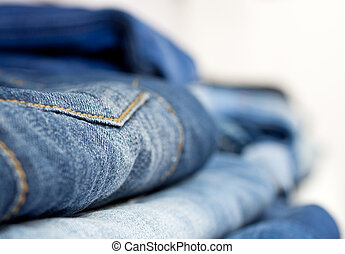 Jeans stacked on a shop