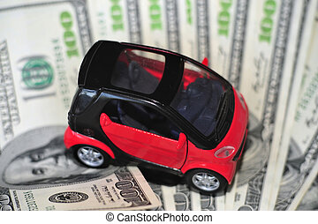 Black and red car over a lot of dollar bills isolated on...