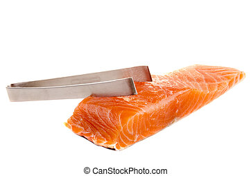 salmon filet and a pliers - boneless salmon filet and a...