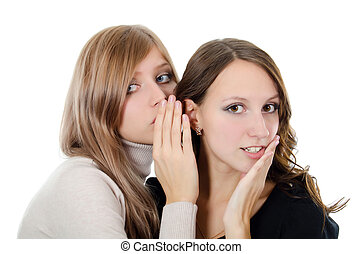 Two girl-friends tell gossips on an ear isolated