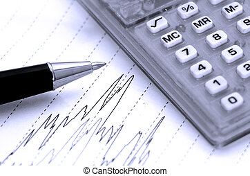Pen and line graph - Pen and calculator rest on a paper with...