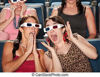 Amazed Women Watch 3d Movie - Two amazed Caucasian women...