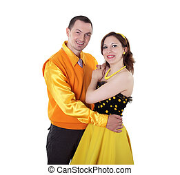 young dancing couple in bright colour wear - young stylish...