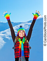 Happy cute girl playing in snow outdoor, Christmas winter holida