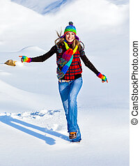 Happy girl running in the snow, teen outdoor winter...