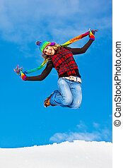 Happy girl jumping over blue sky background, teen outdoor...