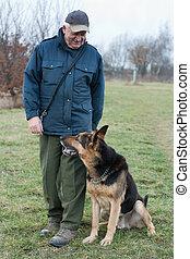 Smart German Shepherd dog/Alsatian and his master