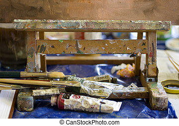 Easel and palette - Atelier. Palette with colors, easel in...