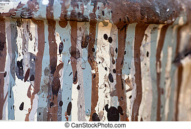 Brown and gray drippings on a dirty white background