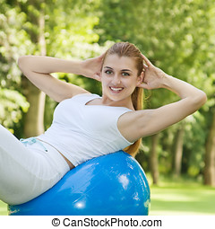 fitness woman - Fitnes woman stretching on pilates ball...