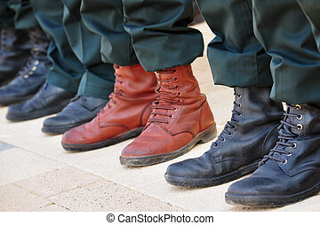 Army Boots Stand Out in a Crowd - An army soldier wears...