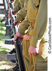 Soldiers Line Uniform Guns