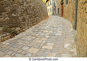 narrow curve street in italian village Montefioralle, Greve in Chianti, Tuscany, Italy, Europe