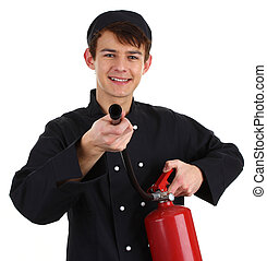 Chef fire fighter - A chef with a fire extinguisher isolated...