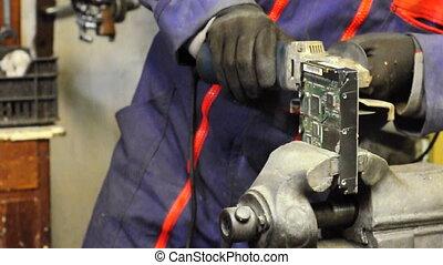 Mechanic worker in action