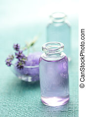 Aromatherapy oil and lavender on light blue background