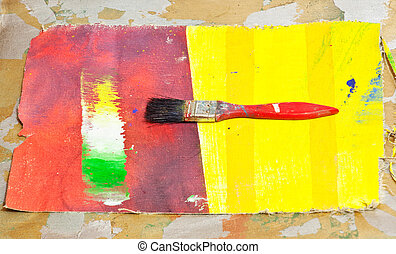 Paintbrush on colorful background