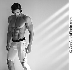 Hot male fitness model - Sexy black and white portrait of...