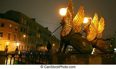 Griffins on Bank Bridge in Saint Petersburg at night