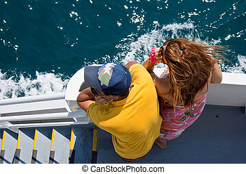 Lovers looking the sea on a ferry boat