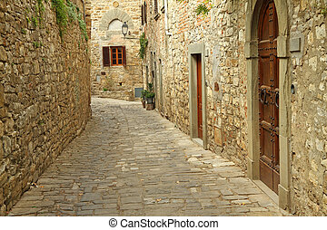 narrow  paved street and stone walls in italian village, Montefioralle, Tuscany, Italy, Europe