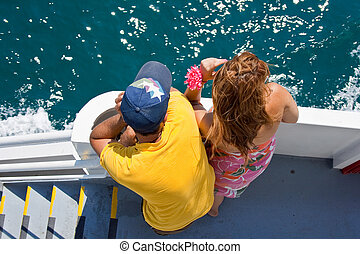 Lovers looking the sea on a ferry boat - young Lovers...