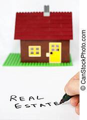 Text real estate and house on background