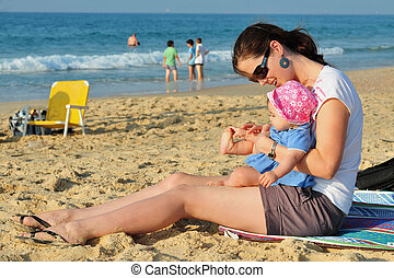 Beach Play Child Mother - A child and her mother play in the...