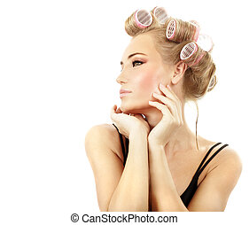 Stylish girl portrait with fashion makeup and hair curlers,...