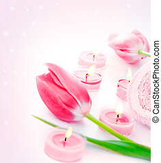Spa candle with pink tulip flowers