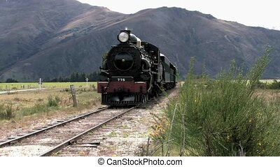 steam train passes - vintage Steam train passing