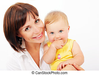 Portrait of a smiling mother & baby isolated over white...