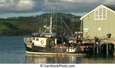 Commercial Fishing Boat - commercial fishing boat tied to...